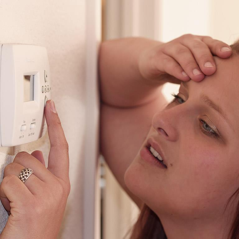Woman in Need of Air Conditioner Repair